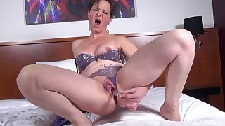 Solo mature with short hair loves respecting poke their way pussy with a dildo