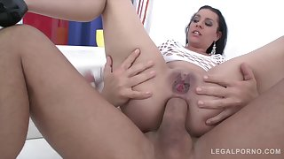 Thrilling brunette in a white, fishnet blouse is getting fucked in get under one's ass and loving it