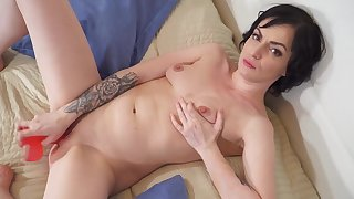 Tainted solo model Darla drills the brush cunt with a unstinted peppery dildo