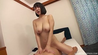 Things are pretty wettish for the busty Japanese mom